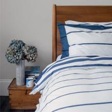 <span>IMIVIMBO is a chic range of home accessories featuring organic, hand-painted stripes.  Its bedlinen is the loveliest I've seen in a very long time.  Needless to say, I have the whole collection.</span>